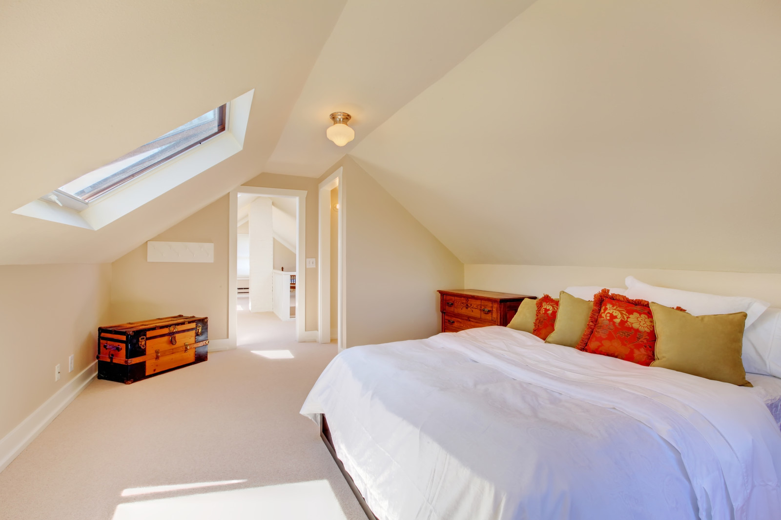 bright clean dormer loft conversion bedroom in the decent size home with beige carpet -ace lofts london ltd