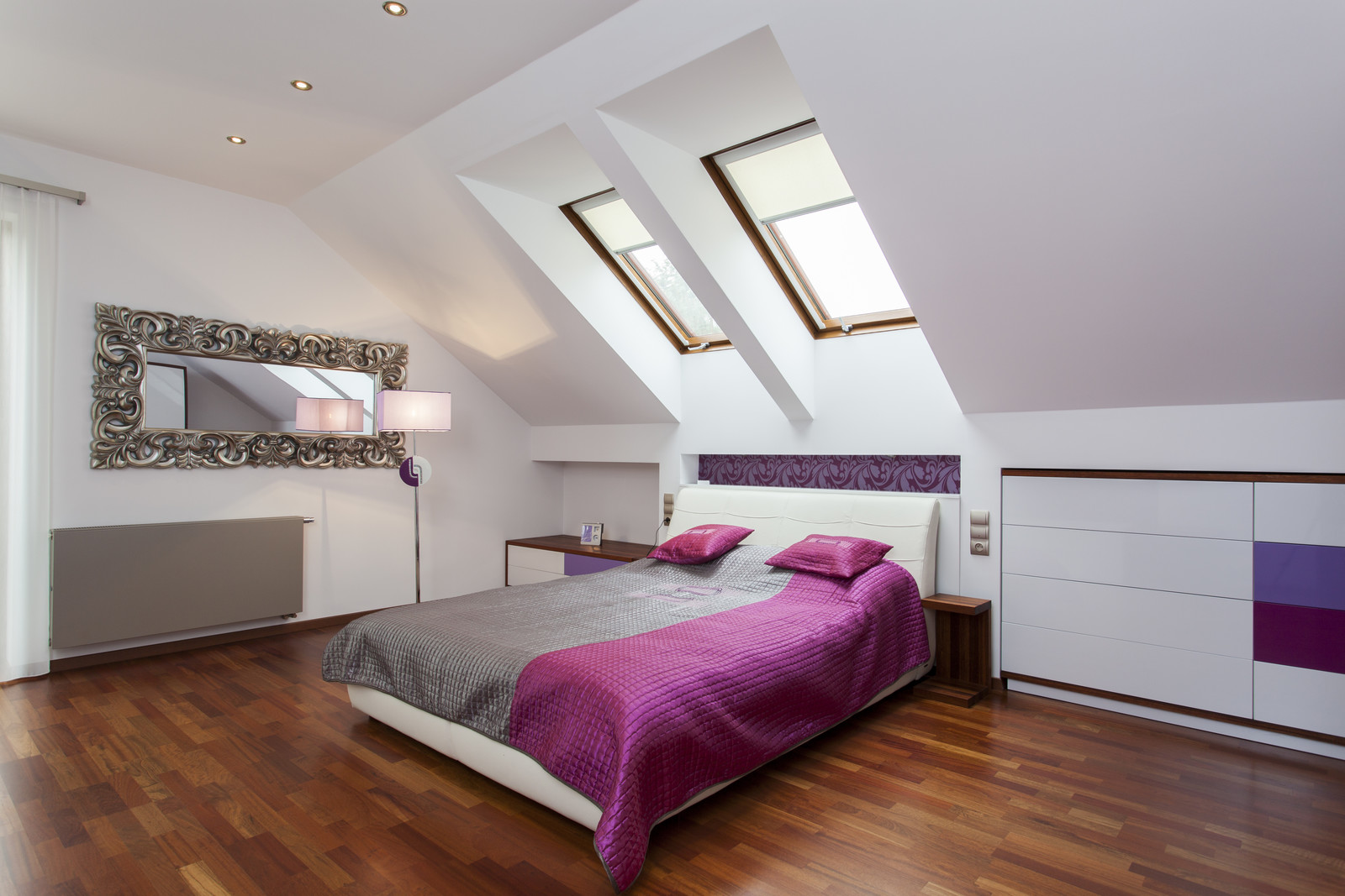 spacious bedroom in the loft of modern home